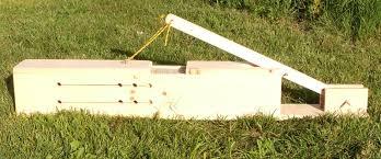 home built mini hay bale press by von