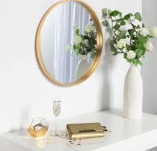 round decorative wall mirror gold