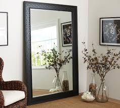 black fretwork floor mirror with