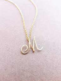 cursive gold letter alphabet initial