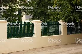 Wooden Garden Fence In Front Of The Residential Building Stock Photo Download Image Now Istock