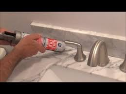 how to apply silicone behind a faucet