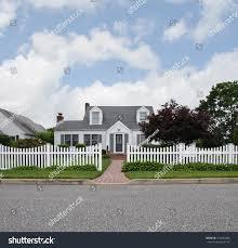 White Suburban Cape Cod Style Home Stock Photo Edit Now 754642885