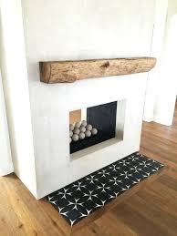 rough mantel grey stucco fireplace