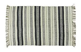 white striped jute rug by madam stoltz