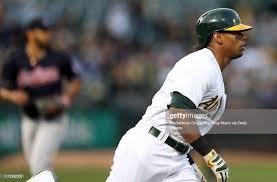 Oakland Athletics' Khris Davis circles the bases on his three-run ...