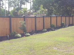 Wood Fence With Black Top And Posts Elite Fencing Wood Fence Garden Design Types Of Fences