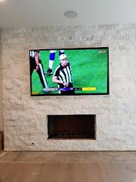 mounting a tv on brick fireplaces the