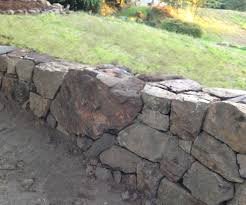 How To Build A Natural Dry Stacked Stone Free Standing Or Retaining Rock Wall 4 Steps With Pictures Instructables
