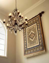 foyer chandelier alongside wall hanging