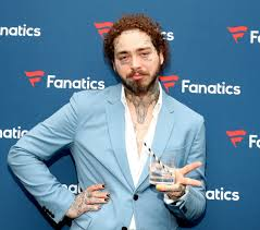 Post Malone shows off yet another face tattoo - National | Globalnews.ca