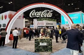 coca cola cuts back on sugar with
