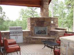 corner fireplace with bbq grill