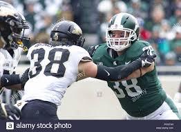 East Lansing, Michigan, USA. 27th Oct, 2018. Purdue Safety BRENNAN  THIENEMAN (38) blocks linebacker BYRON BULLOUGH (