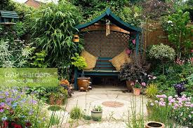 arbour seat in small urban garden