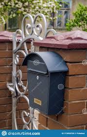 Postal Metal Box On A Brick Fence On The Background Of A Wrought Gate Stock Image Image Of Correspondence Magazines 172095705