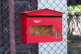 Red Mailbox Hanging On Chain Link Fence Stock Photo Picture And Royalty Free Image Image 79894391