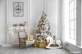 Light Room With Christmas Interior Xmas Tree Decorated With Flashing Garland And Gold Balls Bright Decor With Artificial Fireplace And Kids Rocking Horse Chair Buy This Stock Photo And Explore Similar