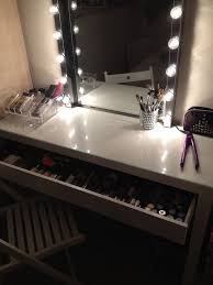 table with lighted mirror