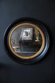 black gold framed convex mirror