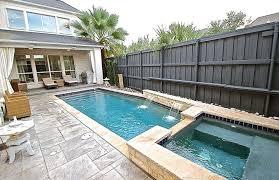 Large Black Painted Wood And Metal Privacy Fence Around Pool Fence Around Pool Small Inground Pool Backyard Pool