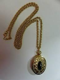 gold tone black stone perfume trinket