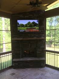 outdoor fireplace in screen porch with