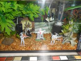 Halloween Decorations In An Aquarium Just Be Careful Not To Put Anything In The Tank That Might Leach Chem Aquarium Decorations Fun Halloween Decor Fish Tank