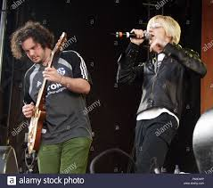 Aaron Kamin and Alex Band of The Calling perform at Centennial Olympic Park  in Atlanta, Georgia on May 24, 2002. CREDIT: Chris McKay / Mediapunch Stock  Photo - Alamy
