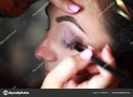wedding makeup artist making a make up