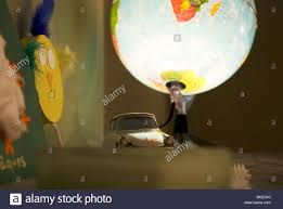 Close Up Of Toy Citroen Car Next To Glowing Globe Lamp On Kids Stock Photo Alamy