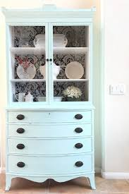 antique hutch makeover with fabric