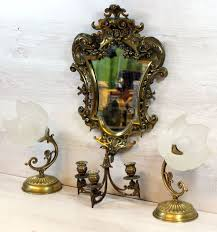 antique brass wall mirror with three