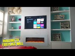 recessed tiled tv fireplace wall