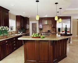 a luxury kitchen with cherry cabinets