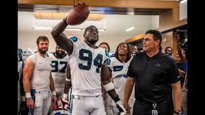 Efe Obada receives game ball in victorious locker room - YouTube