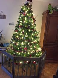 Dog Child Proof Your Christmas Tree For Under 100 Works Great As A Baby Gate Or Dog Barri Childproof Christmas Tree Christmas Tree Gate Christmas Tree Fence