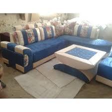 blue and white six seater corner sofa
