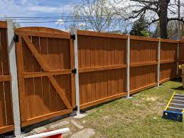 So I Stained My Cedar Fence Yesterday With A Semitransparent Natural Tone Cedar Stain And As You Can See From The Picture It Is Completely Orange This Is Bad Does Anyone Know