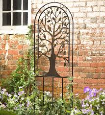 metal arched garden trellis with tree