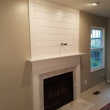 faux shiplap above fireplace mantel yelp