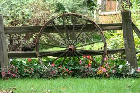 Flowers Fence And A Wagon Wheel Stock Photo Download Image Now Istock