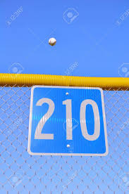 Baseball Flying Over The Fence For A Home Run Stock Photo Picture And Royalty Free Image Image 7592674