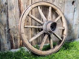 Old Wooden Wagon Wheel Resting Against Rustic Wooden Fence Stock Photo Picture And Royalty Free Image Image 62443840