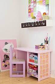 pink child s chair and desk below spice