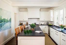 ivory kitchen island with orange