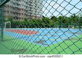 Steel Mesh Fence With Soccer Field Background Wire Mesh Fence With Football Field Background