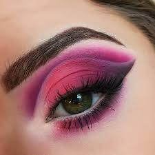 purple and green eye makeup cat eye