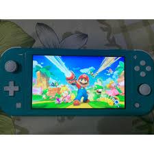 Máy chơi game Nintendo switch lite + 2 băng game, giá chỉ 6,000,000đ! Mua  ngay kẻo hết!