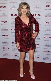 Penny Smith, 58, dons sequinned scarlet mini dress